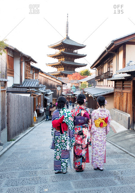 Women in kimonos near Japanese temple