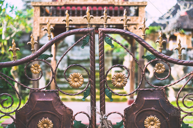 Decorated metal gate at a temple in Ubud, Bali