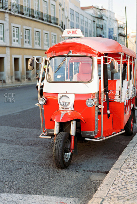 Lisbon, Portugal - July 15, 2015: Red and white Tuk Tuk on the streets of Lisbon, Portugal