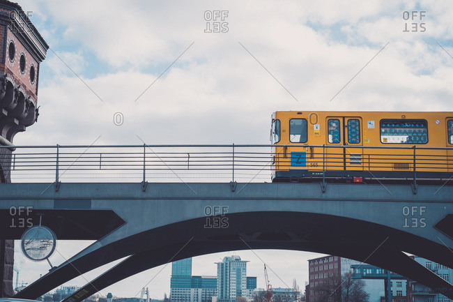 Berlin, Germany - February 28, 2015: A yellow train passing over a metal bridge in Berlin, Germany