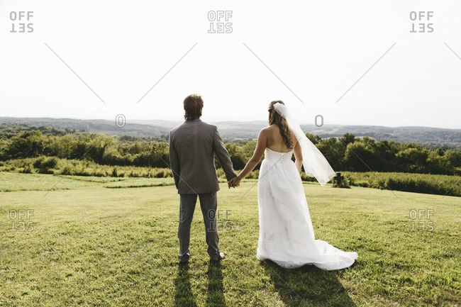 Bridal couple standing in the country