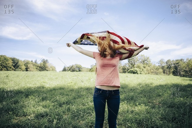 Woman holding up an American flag