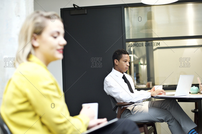 Young business professionals working in a meeting room