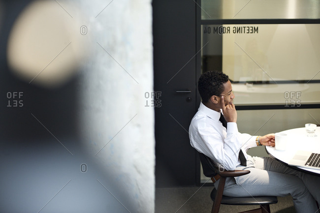 Young business man sitting at a conference table