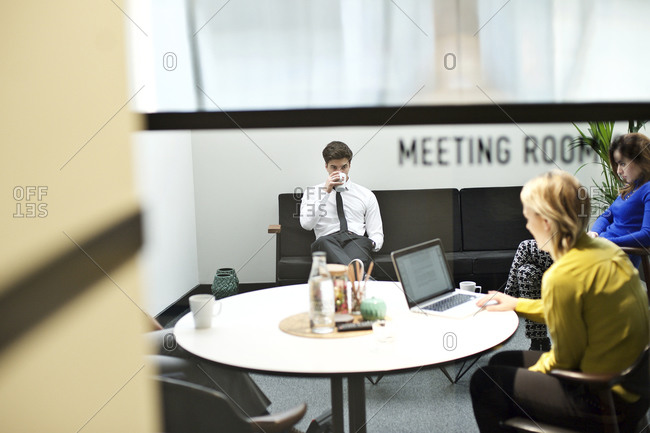 Business professionals working together in a meeting room