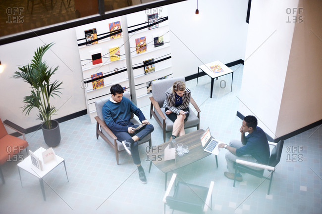 Young business professionals sitting together in a meeting room