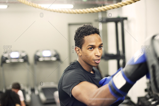 Young man boxing in his company's gym