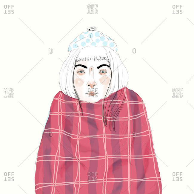 Woman with a cold wrapped in a blanket with ice pack on her head