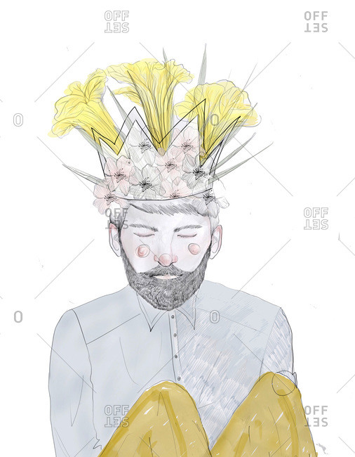 Bearded man with knees up wearing a crown of flowers
