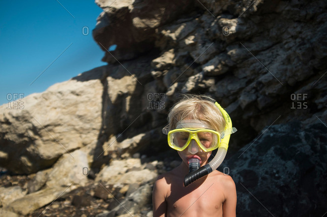 Little boy wearing a snorkeling mask