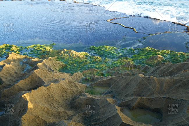 View of rocky tidal pools along coast