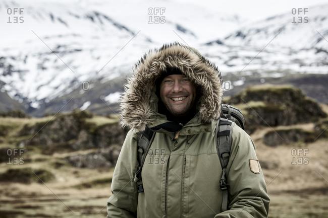 Smiling man in Scandinavian mountains