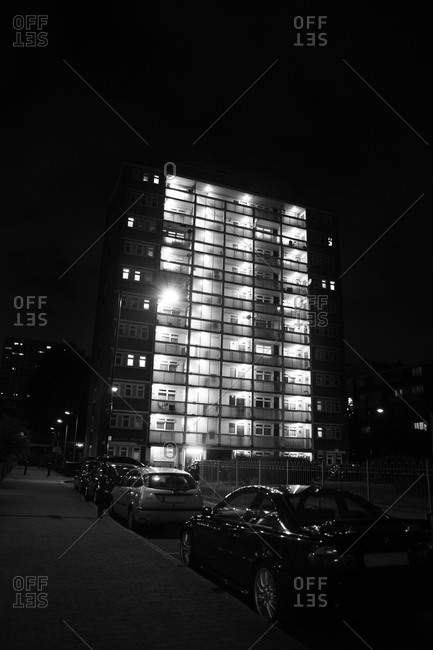 Illuminated block of flats at night, London
