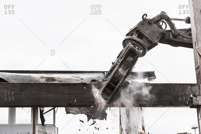 Digger demolishing building, Molndal - Offset