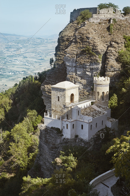Stone building with tower on rocky mountain, Sicily