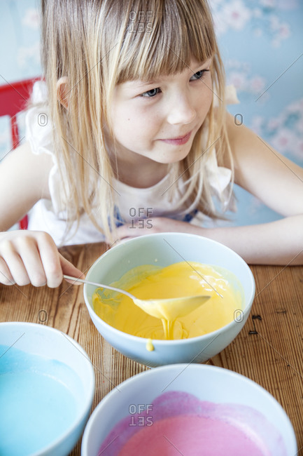 Girl with colorful food in bowls