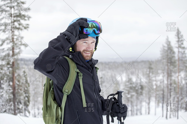 Smiling man skiing