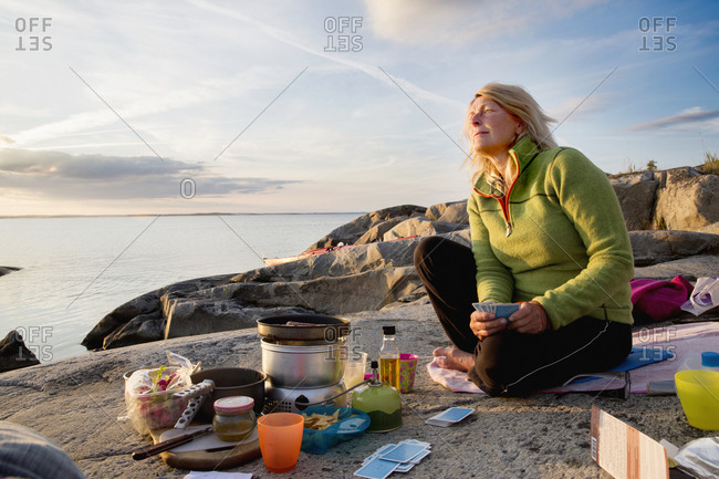 Woman preparing food during camping