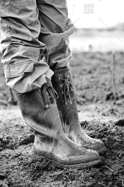 Low-section of woman in rubber boots