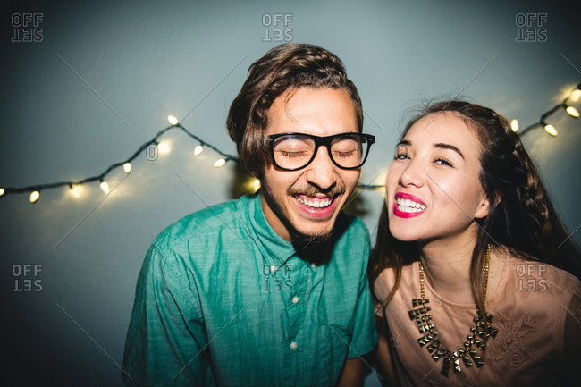 Portrait of happy couple at party