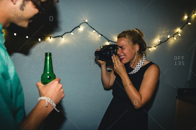 Woman taking photo with camera at party