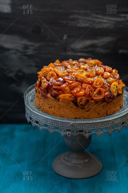 Vanilla cake topped with kumquats