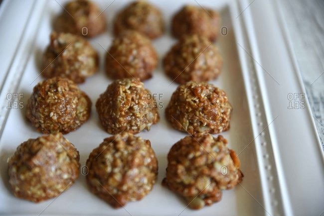 Seeded balls of cookie dough on baking tray