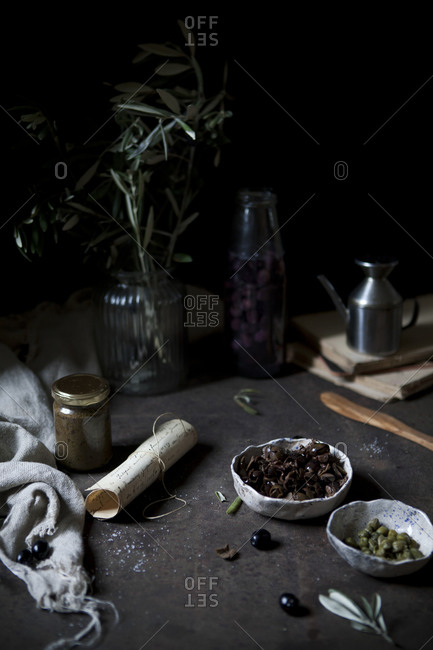 Olives and capers on table