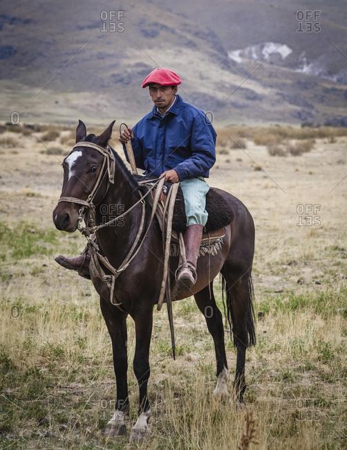 Patagonia, Argentina - February 24, 2012: Gaucho riding a horse at the Huechahue Estancia, Patagonia, Argentina