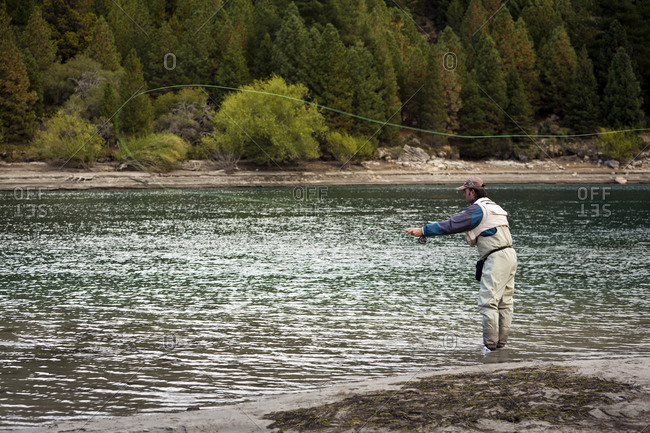 Patagonia, Argentina - February 25, 2012: Fly fishing at the Limay River in the lake district, Patagonia, Argentina