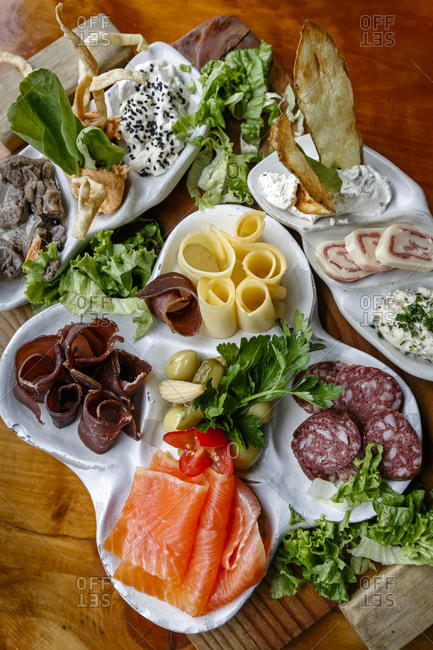 Plate of typical Patagonian food in Familia Weiss restaurant, Bariloche, Patagonia, Argentina