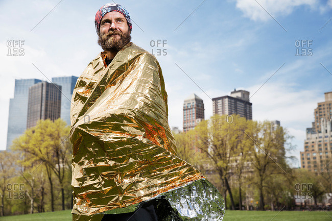 Runner wrapped in space blanket in Central Park