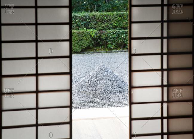 Zen garden viewed through screen doors at Daisen-in Temple in Kyoto, Japan