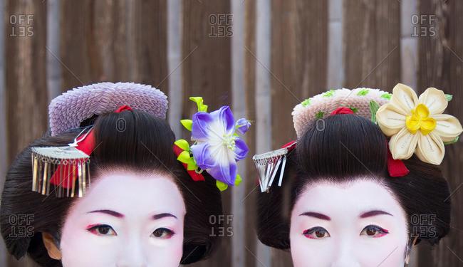 Kyoto, Japan - November 29, 2015: Close-up of the eyes and hair ornaments of two geisha in Kyoto, Japan