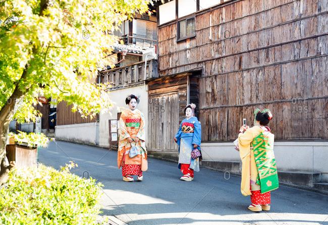 Kyoto, Japan - November 29, 2015: Three geisha on the street in Kyoto, Japan
