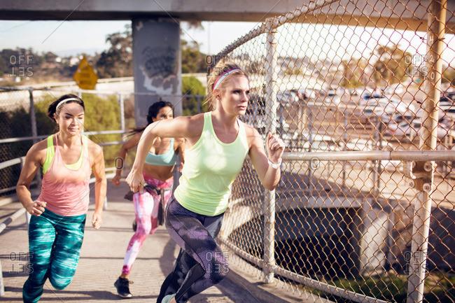 Women running on a pedestrian bridge