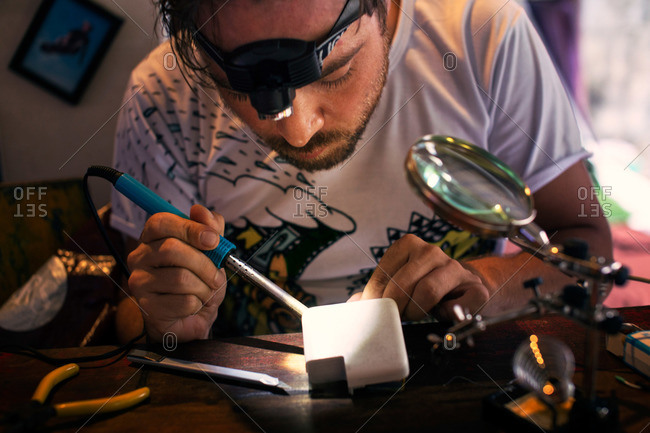 Man soldering an electrical device