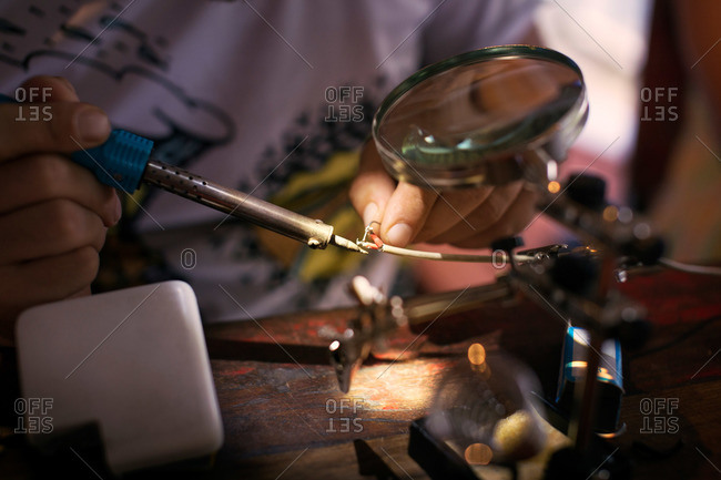 Man soldering electrical wires