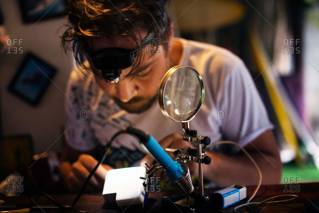 Man repairing a small electrical device