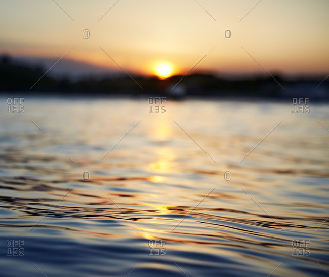 Close-up of water's surface at sunset