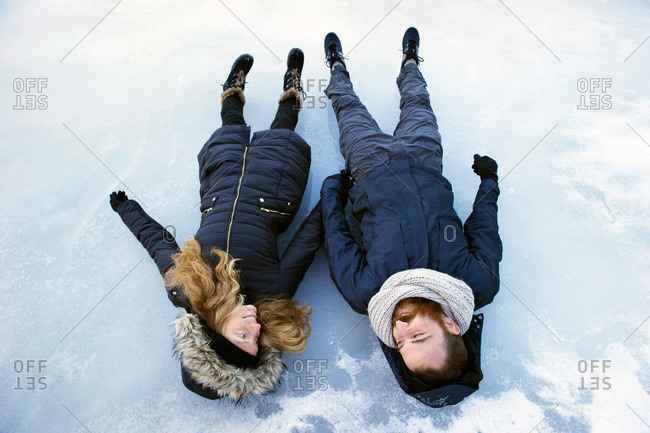 Couple lying in the snow in Frog Lake, Oregon