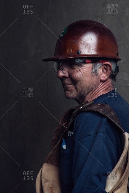 Portrait of a construction worker with hardhat and tool bag