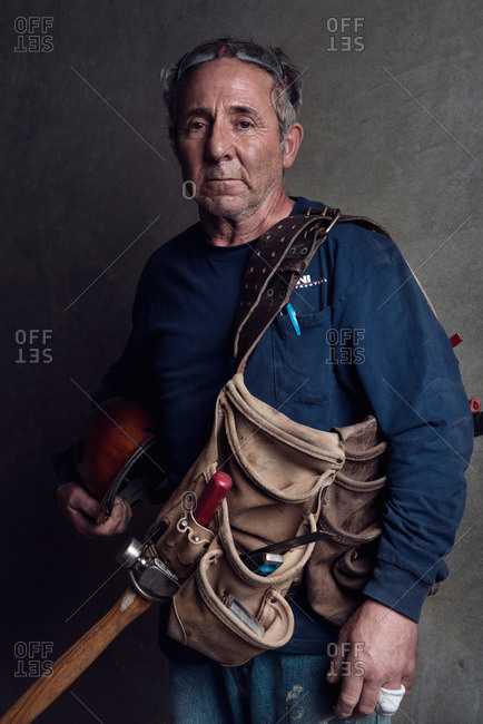 Portrait of a construction worker with tool bag