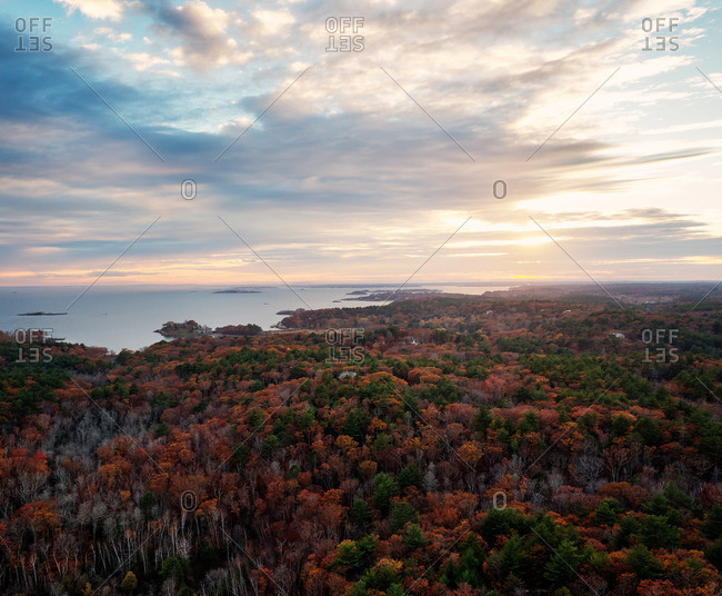 Sunset over a coastal forest in autumn