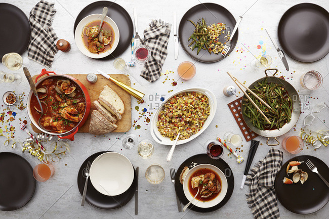 Platters of food on a table decorated for New Year's Eve