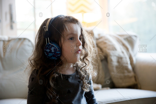 Portrait of a young girl using headphones