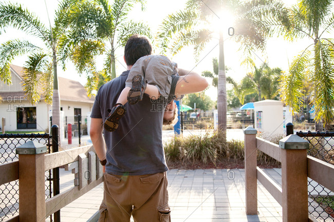 Father carrying son over his shoulder in Florida