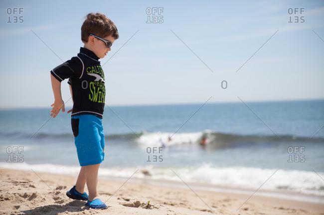 Young boy exploring along the beach