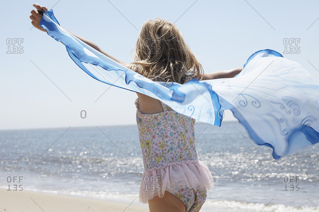 Girl on beach with a light shawl