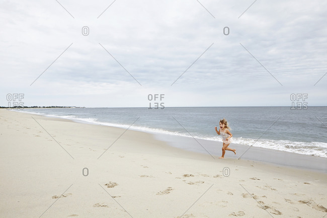 Girl running with excitement on beach